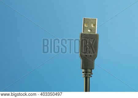 Usb Type A Cable On A Blue Background With Space For Text. Usb Cable For Connecting To Digital Home