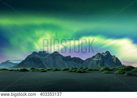 Aurora borealis Northern lights over black sand desert dunes and grassy bumps near famous Stokksnes mountains on Vestrahorn cape, Iceland. Landscape photography. Courtesy of NASA. Photo collage