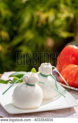 Fresh Italian White Soft Cheese Burrata Or Burratina Served On Outdoor Terrace In Sunny Day