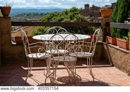 Travel Destination, Iron Table And Chairs In Small Ancient Village Cotignac In Var, Provence, Surrou