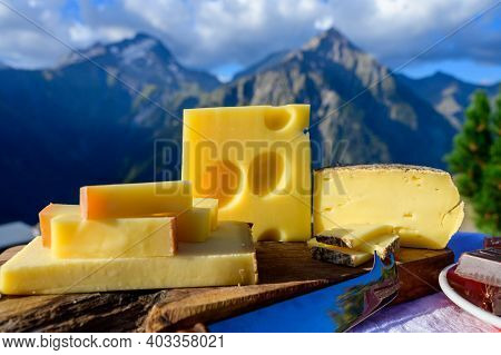 Cheese Collection, French Beaufort, Abondance, Emmental, Tomme De Savoie Cheeses Served Outdoor In S
