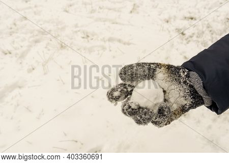 Gloves With Cold Icy Snowball, Concept Winter And Fun Snow Games,