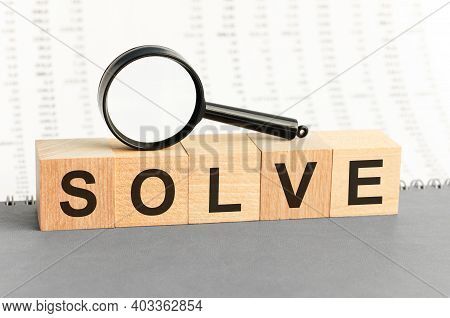 Wooden Blocks With The Text: Solve. Solve Word Made With Building Blocks, Business Concept