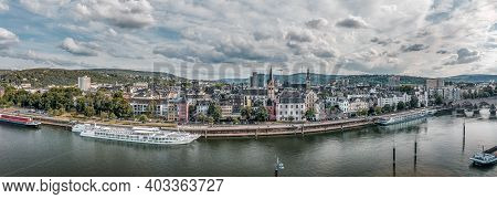 Koblenz, Germany - Aug 1, 2020: Panoramic Aerial Drone Shot Of Quai On Deutsch Eck By Rhine Mosel In