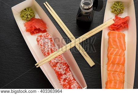 California Sushi With Red Tobiko Caviar And Slices Of Philadelphia Sushi With Eel In A White Box, De