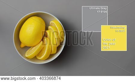 Yellow Lemons In Gray Plate On Gray Background. Colors Of The Year 2021 Illuminating And Ultimate Gr