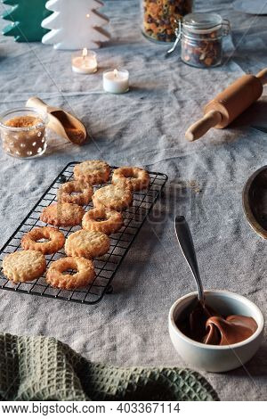 Christmas Linzer Cookies Filled On Cooling Rack, Metal Plate. Sandwich Cookies Filled With Hazelnut