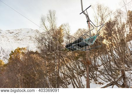 Old Chairlift To The Mountain. Empty Ski Lift Cheget. Winter 2021 In The Mountains.