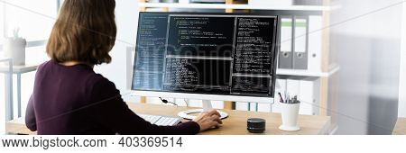 Software Programmer Or Coder Woman Using Office Computer