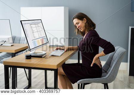 Back Pain At Work. Bad Computer Posture