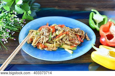 Udon With Chicken And Vegetables In Soy Sauce On Table. For Asian Food Menu