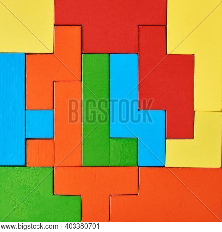 Different Wooden Blocks Background. Concept Of Logical Thinking And Education. Colorful Geometric Sh