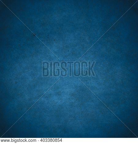 old dark paper, blue background