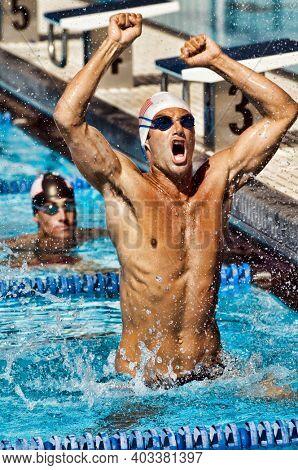 Portrait of Winning Swimmer celebrating winning first place
