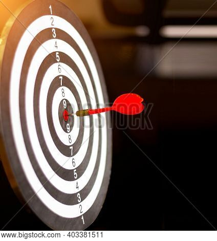 Dart Board Has Dart Arrow Throw Hitting The Center Of A Shooting Target For Business Targeting And W