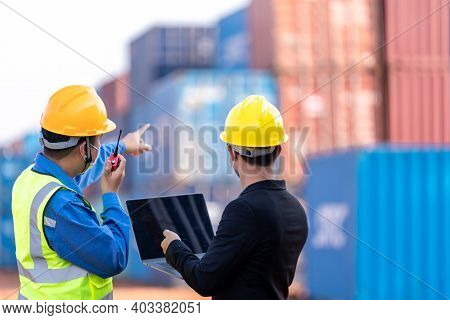 Teamwork, Asian Male Logistic Warehouse Foreman With Worker Using Laptop Checking List Planning And