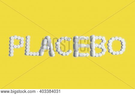 Placebo Is A Medical Concept In Trendy Colors. The Tablets Are Lined With The Word Placebo.ultimate