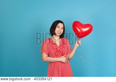 Mock-up Delighted Romantic Young Asian Woman In Red Dress And Dark Hair Holding Flying Red Heart Sha