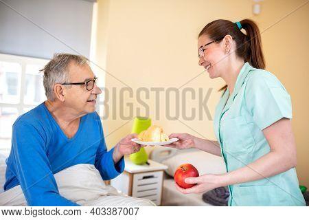 Elders People Home Nurse Making Sure Senior Man Occupant Gets Healthy Food To Eat