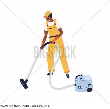 Professional Worker Of Cleaning Service Working With Vacuum Cleaner. Man In Uniform And Gloves Using