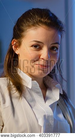 Freelancer Woman Holding Laptop, Writting And Looking At Camera Smiling Standing In Start-up Company