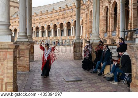 Seville, Spain - 10 January, 2021: Flamenco Music Group And Dancers Performing At The Plaza De Espan
