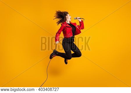 Full Length Body Size View Of Talented Wavy-haired Girl Soloist Vocalist Jumping Enjoying Singing Hi