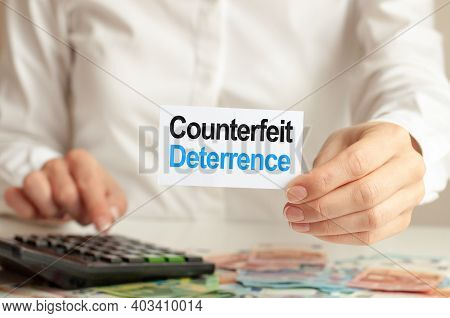 100 Dollars Bill, White Notepad Sheet On The White Background And Calculator. Counterfeit Deterrence