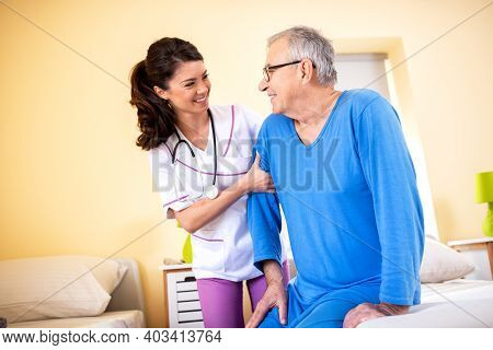 Friendly Nursing Home Lady Doctor With Senior Resident In Elders People Facility