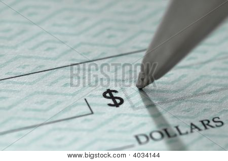 Closeup Of Pen Writing On A Blank Bank Check