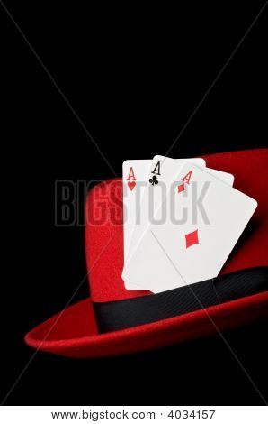Three Aces On Felt Hat, Isolated On Black Background; Concept For Gambling
