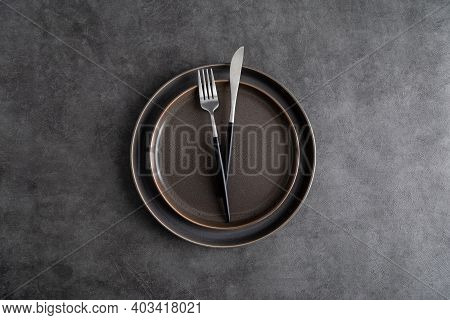 Table Set With Plates And Silverware At Gray Background. Top View, Flat Lay, Concept Of Elegance Dar