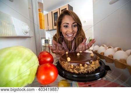 Brunette Girl Happy To See A Juicy, Sweet, Brown And Delicious Cake