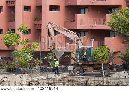 Tenerife, Canary Islands - May 17, 2018. Bulldozer Digging, Building Work Making Noise And Ruining H