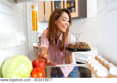 Young Woman In No Dilemma, Cake Is Chosen Over An Apple