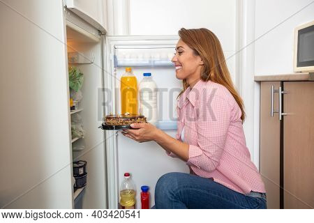 And Now You Are Mine!!! Young Woman Taking The Sweet Tasty Donuts From The Refrigerator
