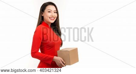 Asian Woman With Ao Dai And Hold Big Gift Box Wish Have A Happy New Year
