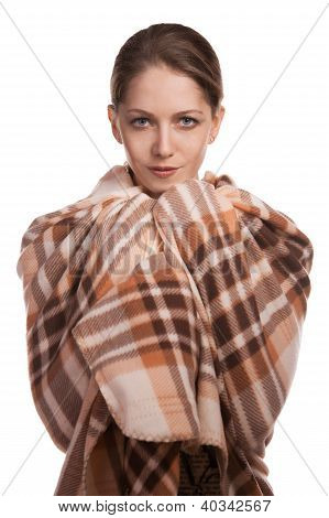Beautiful young woman wrapped in a wool plaid poster