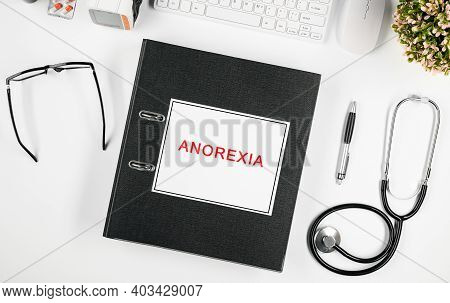 Doctors Workspace, In The Center Is A Folder With The Inscription: Anorexia