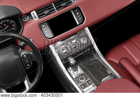 Red Luxury Modern Car Interior. Steering Wheel, Shift Lever And Dashboard. Detail Of Modern Car Inte