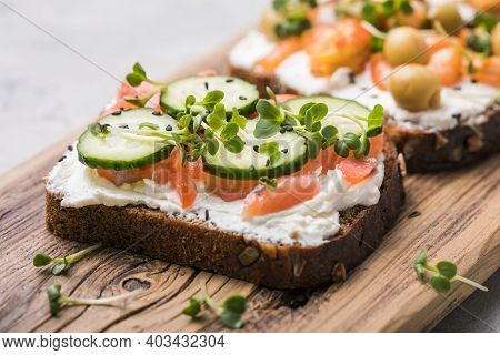 Salmon Toast With A Micro-green On  Wooden Background,  Concept Of Healthy Eating,  Assortment Of Br