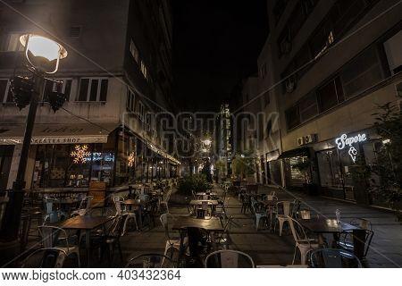 Belgrade, Serbia - December 10, 2020: Empty Terrace And Patio Of A Bar Restaurant At Night Closed Du