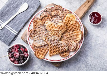 Freshly Baked Homemade Heart Shaped Belgium Waffles  On Gray Background. European Baked Pastry Sweet