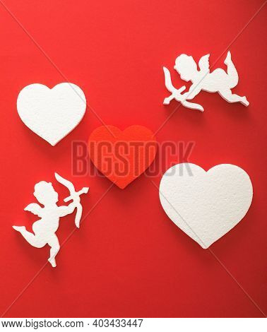 Flying Cupid Silhouette With Hearts, Gifts, Happy Valentine's Day Banners, Paper Art Style. Amour On