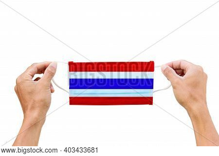 Face Masks On White Background With Thai Flag Paint -  Hold The Hygienic Mask On White Background Wi