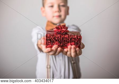 Five Year Old Smiling Boy Give  A Red  Gift, Valentines Day.valentine Gift. Personal Gift. Mothers D