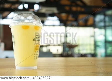 Ubon Ratchathani, Thailand - April 4, 2020: Buy Iced Mango Tango At Cafe Amazon Coffee To Drink Cold