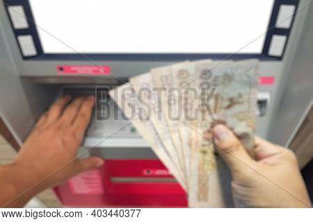 Blurred Close Up Withdraw Bank Notes In The Hand Of Five Thousand Baht From The Atm.unemployment Ben