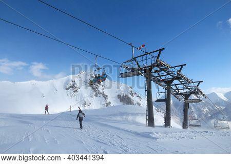 Bad Hofgastein, Austria - March 9, 2016: People Ride A Ski Lift In Bad Hofgastein. It Is Part Of Ski