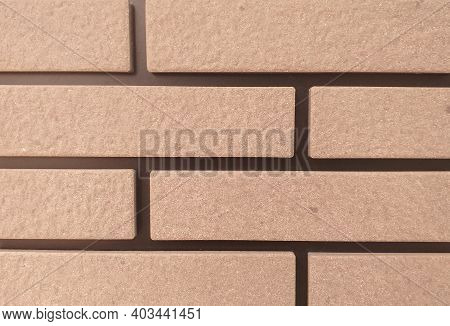The Sandstone Wall Is A Square Wall Arranged In A Row. Background.texture Of Golden Sandstone Bricks